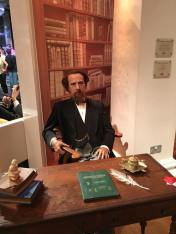 Charles Dickens at his desk